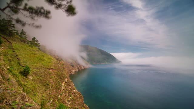 ロシア バイカル湖晴れた日の丘パノラマ 4 k 時間経過シベリア - シベリア点の映像素材/bロール