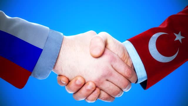 russland - türkei / handshake konzept animation über länder und politik / mit matte kanal - ankara türkei stock-videos und b-roll-filmmaterial