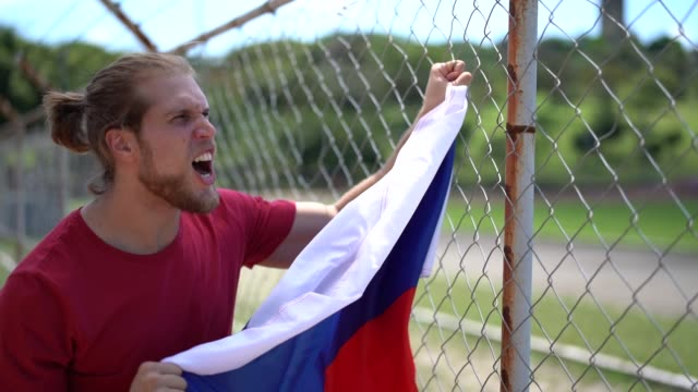 Russian fan watching a sport game The passion of be a soccer fan russian ethnicity stock videos & royalty-free footage