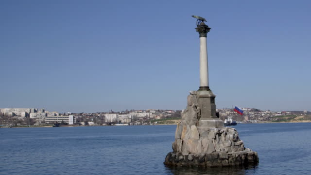 Russian flag on Sunken Ships Monument in Sevastopol Russian flag on Sunken Ships Monument, symbol of Sevastopol, Crimea russian culture stock videos & royalty-free footage