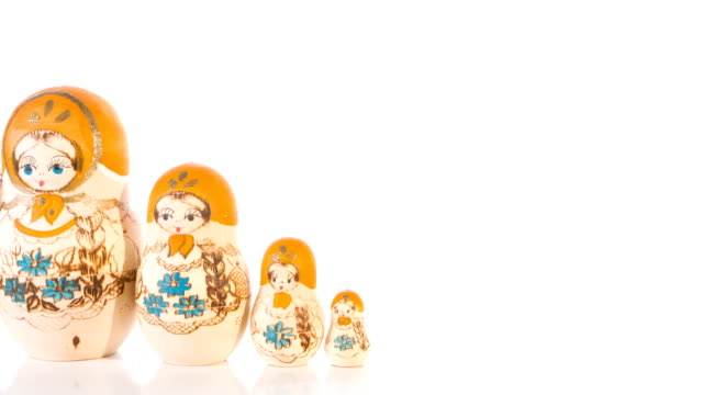 Russian Matryoshka dolls on white background, hand painted babushka video
