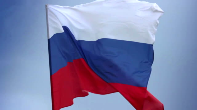 Russian national flag waving on flagpole in blue sky. Russia video