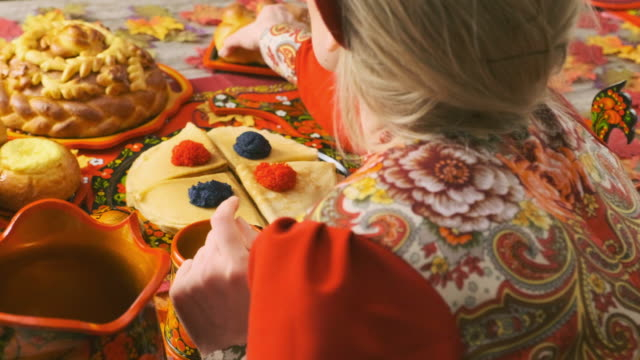russian traditional holiday bread on a table - top down view - nazionalità russa video stock e b–roll