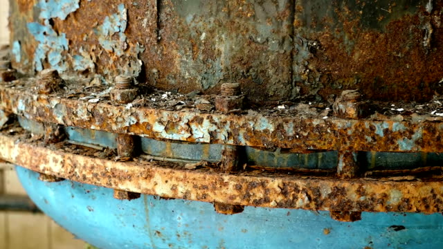 Rusted nuts of the boiler in the abandoned factory. Smooth and slow dolly shot. video