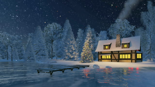 Rustic house and christmas tree at snowfall night video