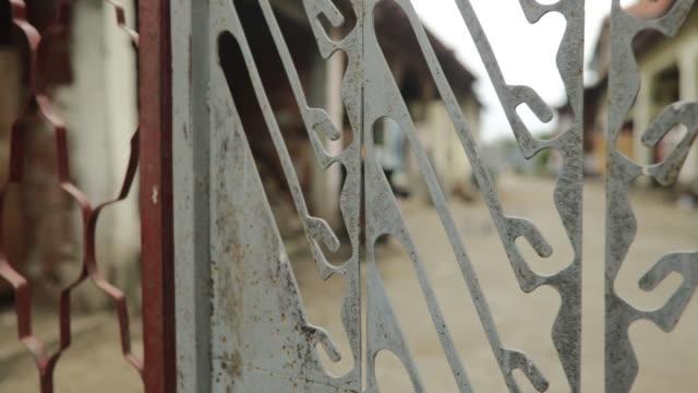 Rustic metal fence in the yard
