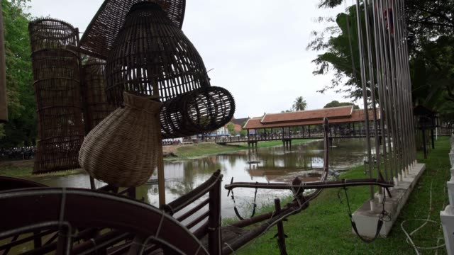 4K, Rustic wooden carriage in centre of Siem Reap city with water of river.