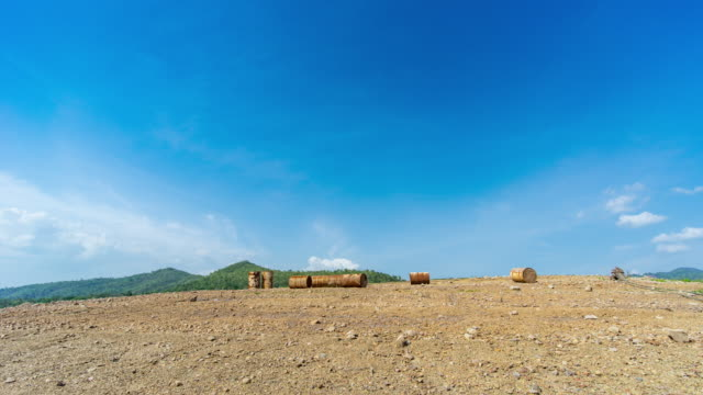 Rusty Oil Barrel on Hill with Blue Sky Background, Time Lapse Video