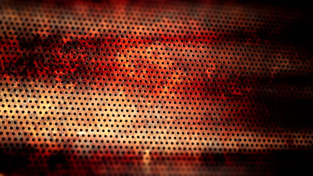 Rusty perforated metal sheet animated video background.