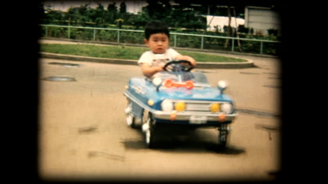 60's 8mm footage - Boy playing with a toy car