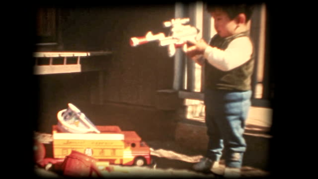 60's 8mm footage - Boy playing with a toy gun video