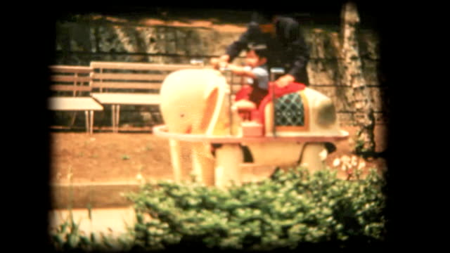 60's 8mm footage - Boy riding on Vehicle elephant