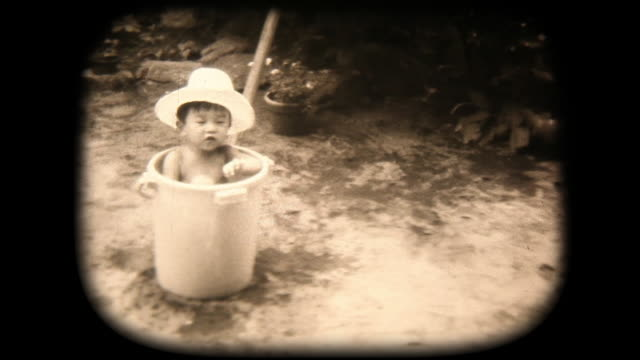 60's 8mm footage - Boys playing with buckets of water