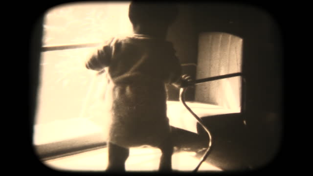 60's 8mm footage - climbs into baby chair