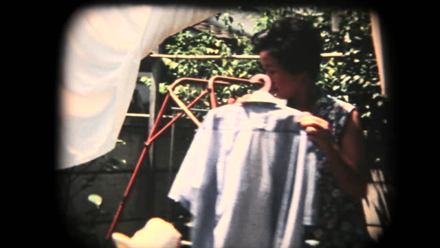 60's 8mm footage - hanging clothes after laundry