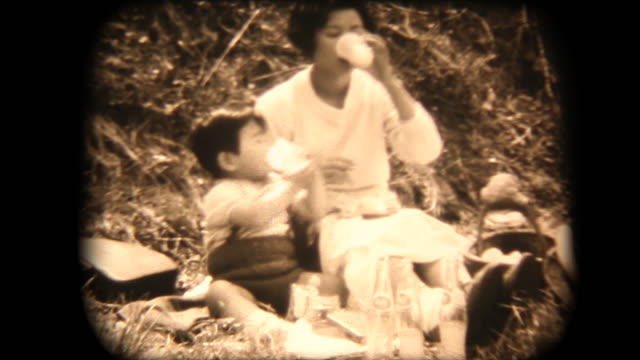 60's 8mm footage - Mother and son having a picnic