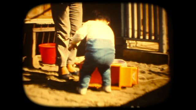 60's 8mm footage - Play with toys track with mum