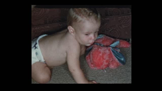 1950's baby boy in diapers crawling around - hotel reception filmów i materiałów b-roll