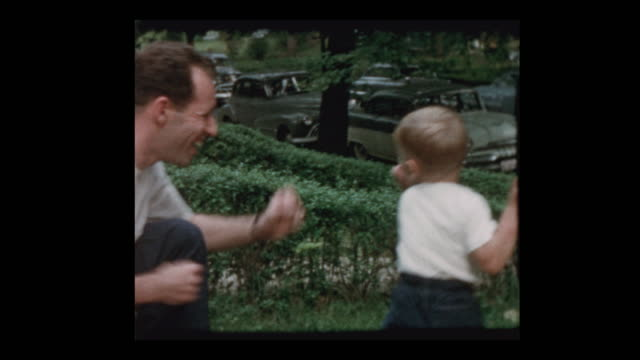 50's dad and young son play fighting, box and rough house - wrestling stock videos and b-roll footage