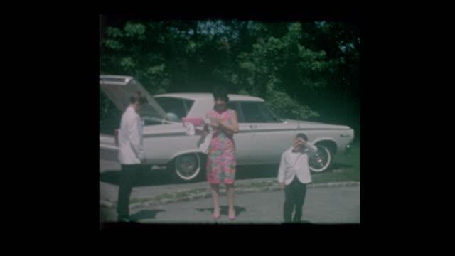 1960's Dressed Formal family arrives for wedding