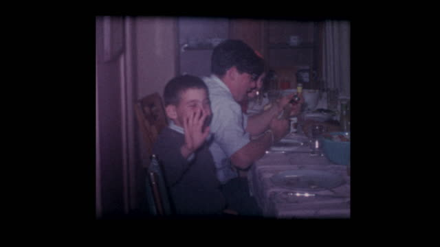 1960's family around thanksgiving dinner table - cena natale video stock e b–roll