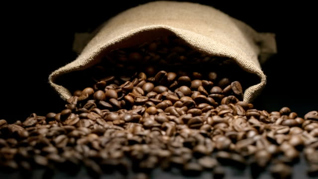 slow motion: sac falls and coffee beans fall out from him - coffee stock videos & royalty-free footage