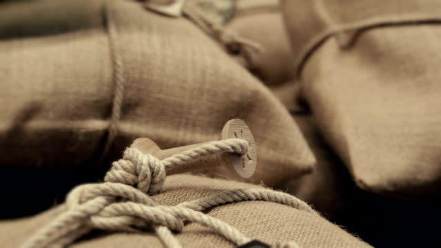 Sacks with cereals tied with rope video