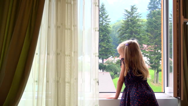 Sad Alone Child Looking Out Window Glass, Pensive Bored Girl video