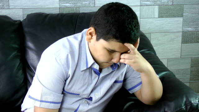 Sad boy. Depressed child at home. Family problems. video