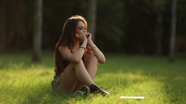 Sad depressed girl. Lonely woman alone upset sitting in park outdoors , lady having troubles, anxiety and stressed out Sad depressed girl. Lonely woman alone upset sitting in park outdoors , lady having troubles, anxiety and stressed out relationship breakup stock videos & royalty-free footage