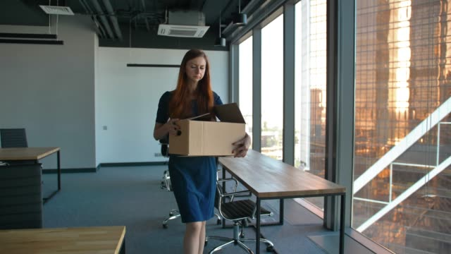 sad female employee leaving the office after being fired - unemployment stock videos & royalty-free footage
