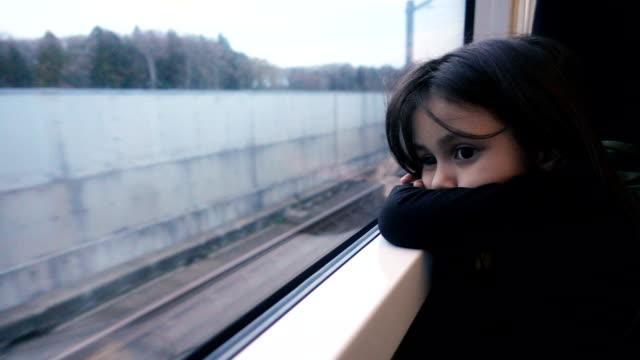 Sad girl sitting in the subway video