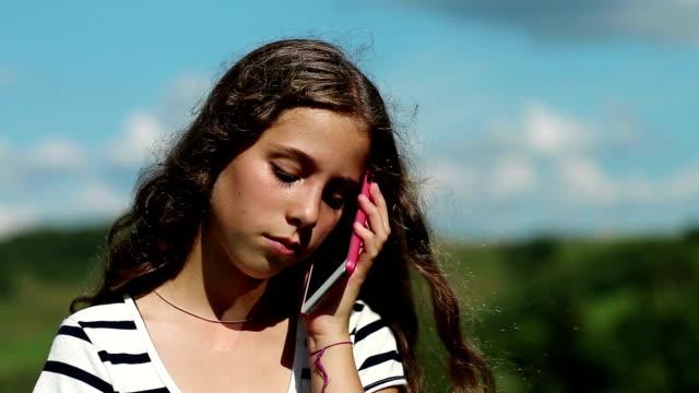 Sad girl talks on smartphone video
