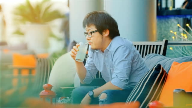 Sad Lonely Asian Man Drinking Alone at the restaurant in anticipation video