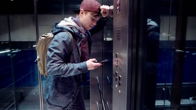 Sad man experienced stress and descends in the elevator in the subway video