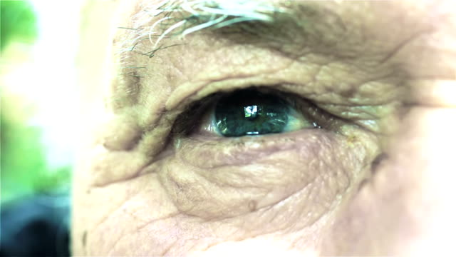 sad man eye: closeup footage on old man's eyes and look video