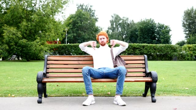 Sad Man Gesture of Thumbs Down in Park, Red Hairs and Beard video