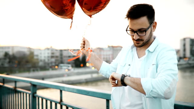 Sad man waiting for date on valentine date video