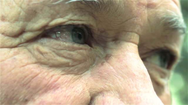 sad old man portrait: closeup portrait on eyes of a old man video