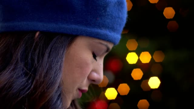 sad pensive lonely woman alone at Christmas- outdoor- profile