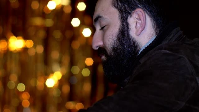 sad pensve man with closed eyes, opening- christms time- profile - samotność filmów i materiałów b-roll