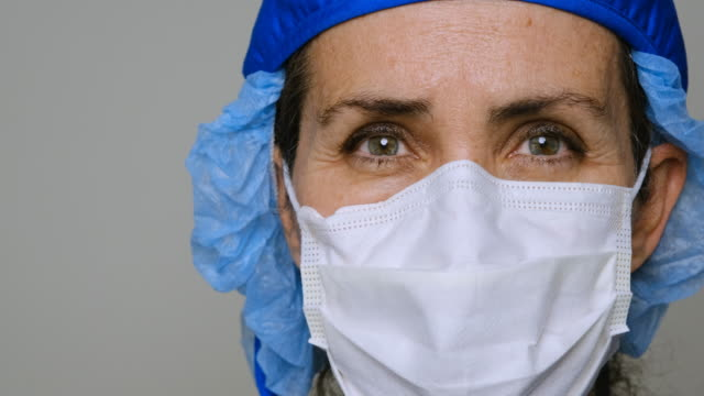 sad, sick, overworked, female health care worker - face mask stock videos & royalty-free footage