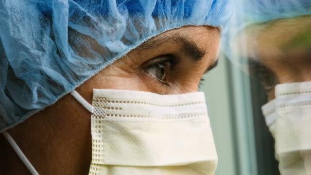 Sad, sick, overworked, female health care worker