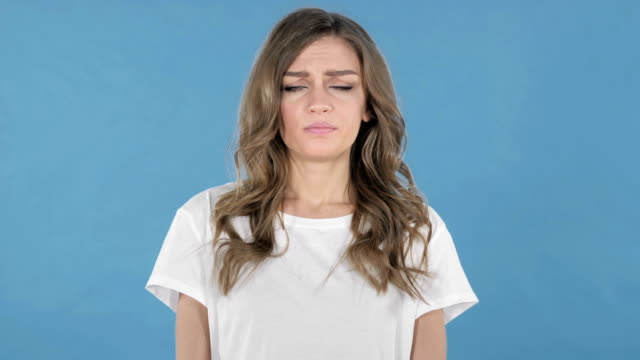 Sad Upset Young Girl Isolated on Blue Background Sad Upset Young Girl Isolated on Blue Background disgust stock videos & royalty-free footage