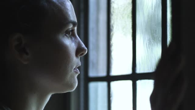 HD: Sad woman at the window