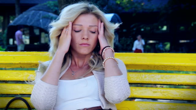 Sad woman close having headache broken relationships heart break video
