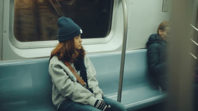 Sad woman sitting in the subway Women, Train, Lonely, Looking underground stock videos & royalty-free footage