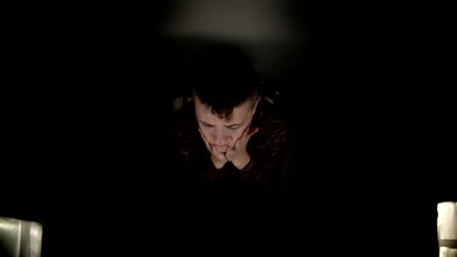 Sad young man looking at camera. video
