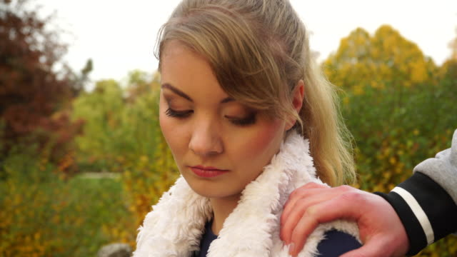 sad young woman outdoors with friend - sostegno emotivo video stock e b–roll