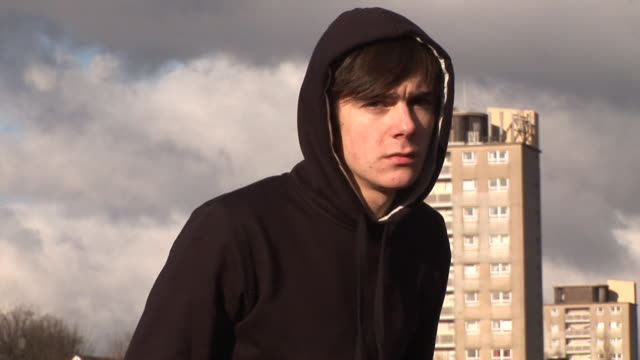 Sad youth / Hoody on council estate with flats behind video